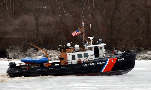 After surging upriver under power on Saturday, the Coast Guard cutter Bridle (WYTL 65607) drives onto the ice jamming the Penobscot River near the Veterans Remembrance Bridge. The Bridle and its sister cutter, the Tackle (WYTL 65604), are breaking ice on the Penobscot as far upriver as Bangor.