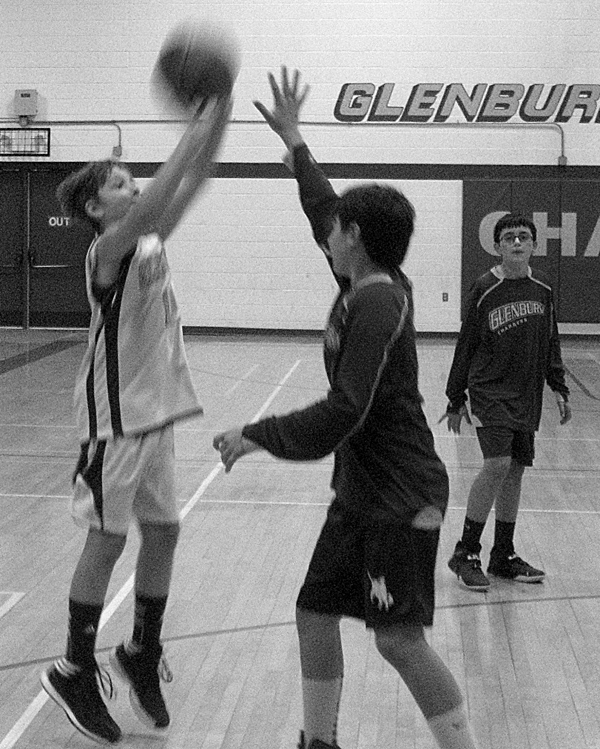Guarded by Logan Hafford, Henry Westrich of Glenburn launches a shot at the basket during the Jan. 7, 2014 practice session of the Glenburn 5/6 basketball travel team. Watching is Dawson Smith. All three players live in Glenburn.