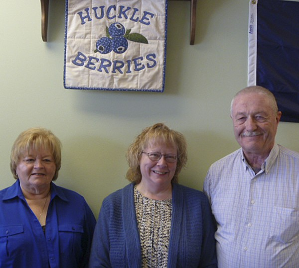 Located in the Brewer Shopping Center on Wilson Street in Brewer, Huckleberries will hold its grand opening Jan. 31 and Feb. 1. Preparing for the event are owners Diane and Lee Stimpson (center and right) and employee Bev Kennedy. The quilted &quotHuckleberries&quot sign was crafted by Diane's sister, Lynn Poulin.