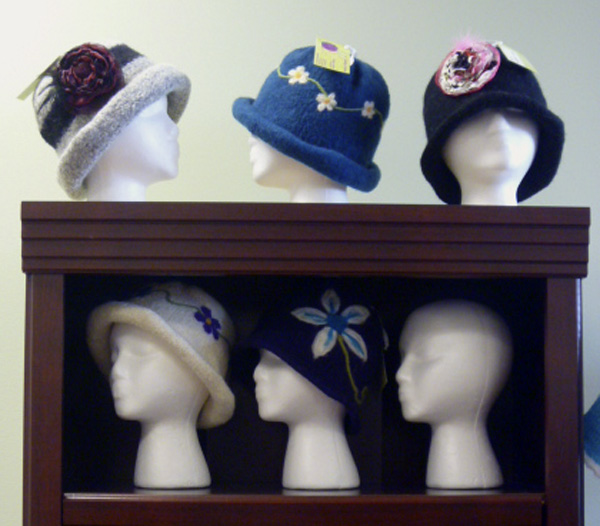 Knitted and felted wool hats crafted in Orrington line shelves at Huckleberries in the Brewer Shopping Center.