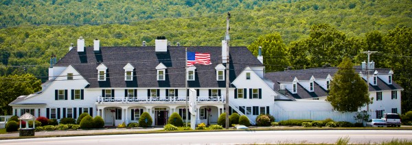 Rising on a hill high above Phillips Lake in Dedham, The Lucerne Inn serves meals and provides lodgings for guests from around the world. Nathan Phillips established the original inn in 1814; he called it the Lake House.