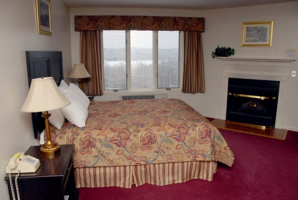 A standard room at The Lucerne Inn contains many amenities, including a 32-inch flat screen TV, custom-made drapes and matching bed covers, a gas fireplace, and a heated towel bar.