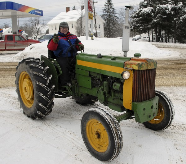 With the air temperature hovering around 10 degrees, Romeo St. Pierre of Carmel drove his 1953 John Deere Model 40U tractor to Dick's Mini-Mart in Carmel Village on Jan. 4. At the store St. Pierre gassed up the tractor, which had started immediately that morning despite the recent bout of bitter weather. He stores the tractor in an unheated building.