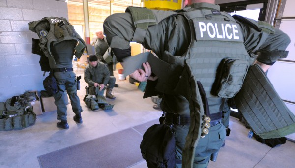 Members of the Bangor Police Special Response Team put on their protectice gear during a drill at the Bangor Daily News building Wednesday.
