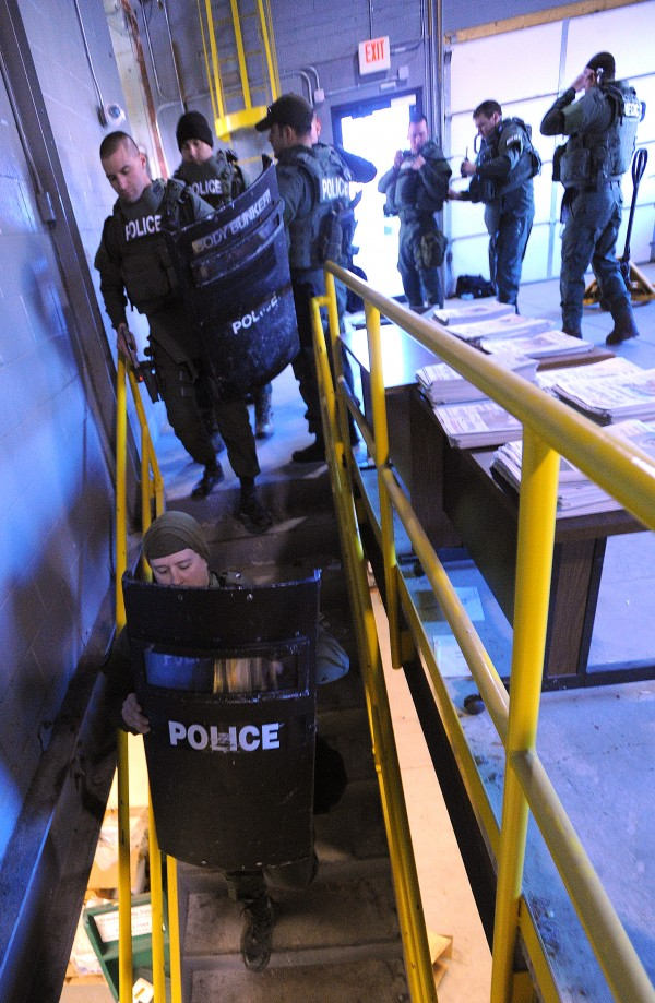 Members of the Bangor Police Special Response Team during a drill at the Bangor Daily News building Wednesday.