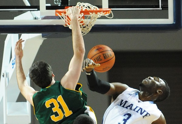 UMaine's Marko Pirovic can't stop Vermont's Troy Reid-Knight's slam dunk during first-half action on Thursday night at the Cross Insurance Center in Bangor.