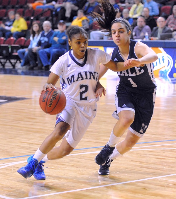 The University of Maine's Cherrish Wallace (left) drives past Yale University's Sarah Halejian during their game at the Cross Insurance Center in Bangor Sunday.