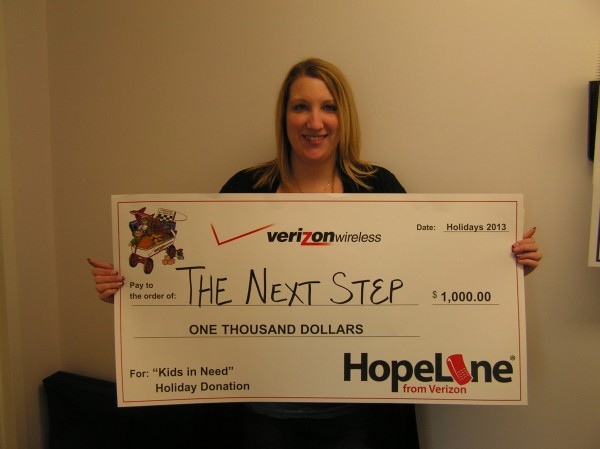 Accepting the donation for The Next Step is advocate Angie Butler.