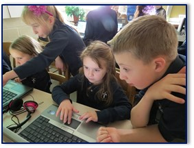 From left, Isabelle Giguere (kindergarten), Alaina Lambert (grade four), Kylie Hines (kindergarten), and Aidan Larrabee (grade four).