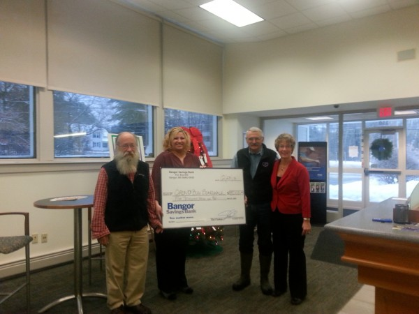Pictured left to right, Jim Bird, Orono Bog Boardwalk Director, Aimee Libbey, Bangor Savings Bank Orono Assistant Branch Manager, Jerry Longcore, Orono Bog Boardwalk Management Committee, and Lori Smart, Bangor Savings Bank Consumer Banking Relationship Manager