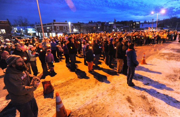 About 200 people gathered at the Ellsworth Town Hall vigil to remember Hilary Saenz, 29, who was found murdered on Christmas Day.