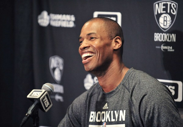 Brooklyn Nets Jason Collins speaks to media before playing against the Los Angeles Lakers at Staples Center in Los Angeles in this file photo taken February 23, 2014.