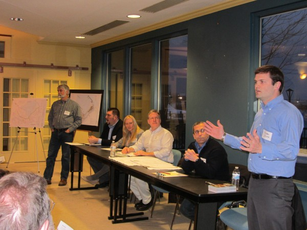 Engineer Tyler Smith (right) describes plans for a four-story hotel on Rockland's waterfront during a Wednesday night meeting with neighbors. Developer Stuart Smith is standing at the far left.