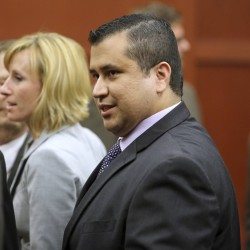 Florida police question Zimmerman after wife reports gun threat