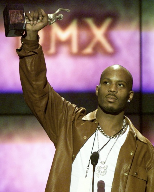 In this  March 2000 file photo, rapper DMX holds up award for &quotMale Entertainer of the Year&quot at the 14th annual Soul Train Music Awards in Los Angeles, Calif.