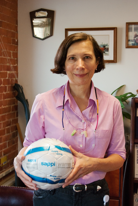 Donna Cassese, manager of Sappi Fine Paper's mill in Westbrook, holds a soccer ball, the texture for which was produced using Sappi's release papers.