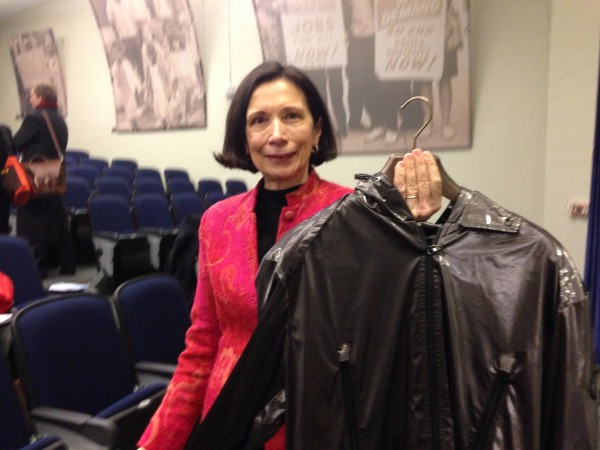 Donna Cassese, manager of Sappi Fine Paper's Westbrook mill, holds up an $800 designer jacket from a well-known retailer that was made with release paper produced at the Westbrook Mill.