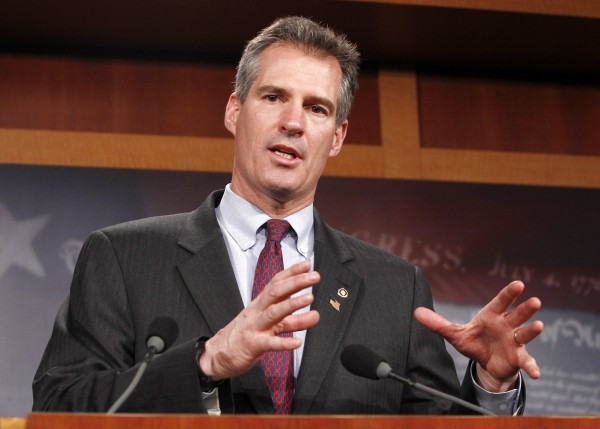Former Massachusetts Sen. Scott Brown speaks after his ceremonial swearing-in at the U.S. Capitol in this 2010 photograph. After losing to Democrat Elizabeth Warren in 2012, Brown is considering a run in neighboring New Hampshire.