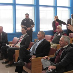 Commissioner Joseph Ponte (left) and Gov. Paul LePage (center, seated) were among the state officials attending an open house at the Maine State Prison in this Feb. 14, 2014 photo.