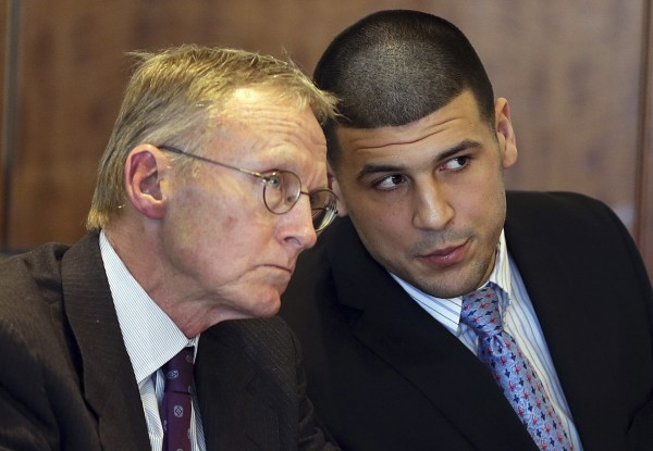 Aaron Hernandez (right) chats with his lawyer Charles Rankin at a pre-trial hearing at Bristol County Superior Court in Fall River, Mass. on Feb. 7, 2014.