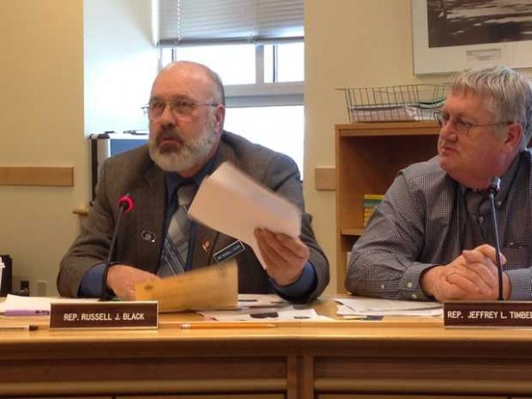 State Rep. Russell Black, R-Wilton, left, asks a question during a work session on a bill that would allow Maine Forest Service rangers to carry sidearms. Looking on is state Rep. Jeff Timberlake, R-Turner, right.