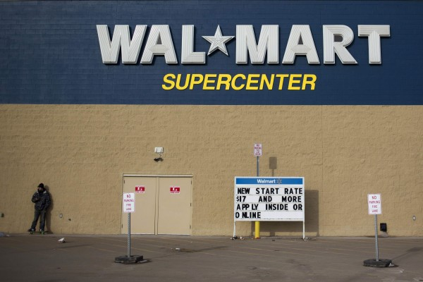 A man stands on a skateboard outside a Wal-Mart store in Williston, N.D. in this March 2013 file photo.