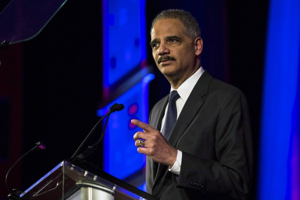 United States Attorney General Eric Holder speaks during the Human Rights Campaign's 13th annual Greater New York Gala in the Manhattan borough of New York, February 8, 2014. Holder plans widespread changes within the U.S. Justice Department to benefit same-sex married couples, such as recognizing a legal right for them not to testify against each other in civil and criminal cases.