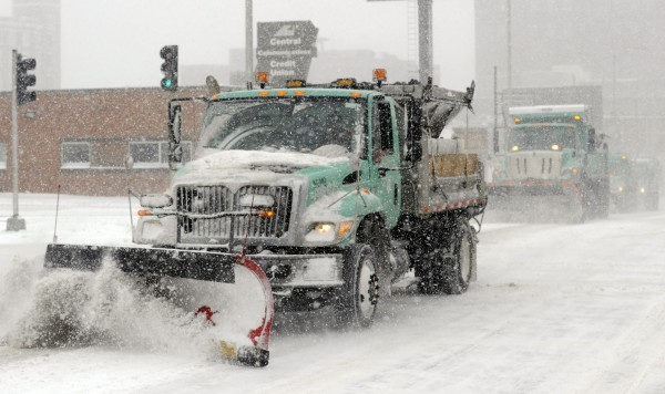 Snowplows team up to clear a downtown street during a blizzard that covered the  metro area in Kansas City, Missouri, February 4, 2014.