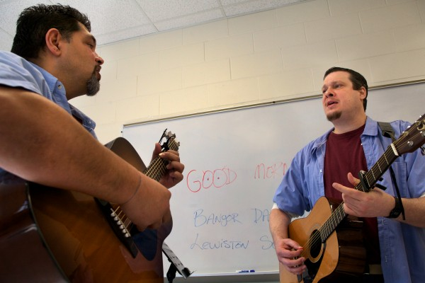 Robert &quotPaco&quot Payzant (left) and Nathan Roy sing in two-part harmony on a song Roy wrote at the Maine State Prison in Warren on Friday. The pair are part of a band made up of prison hospice volunteers.