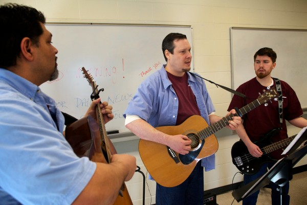 Inmates Robert &quotPaco&quot Payzant (from left) Nathan Roy and Chris Shumway play a song in the Maine State Prison in Warren on Friday. The trio are part of a band of hospice volunteers that will release a CD in February.