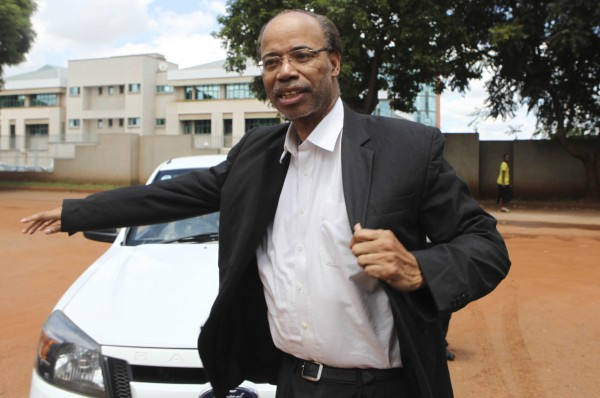Former U.S. congressman Mel Reynolds arrives at the Harare Magistrates court, February 19, 2014. Reynolds has been arrested in Zimbabwe, an immigration official said on Tuesday, after state media reported the convicted sex offender had been found with pornography at a local hotel.