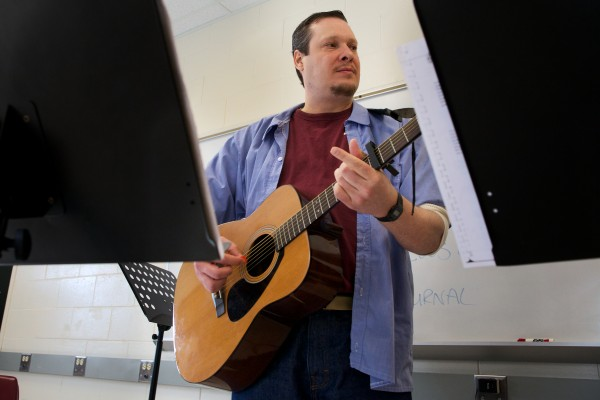 Nathan Roy plays guitar in a band at the Maine State Prison in Warren on Friday made up of hospice volunteers. The band will release a CD in February.