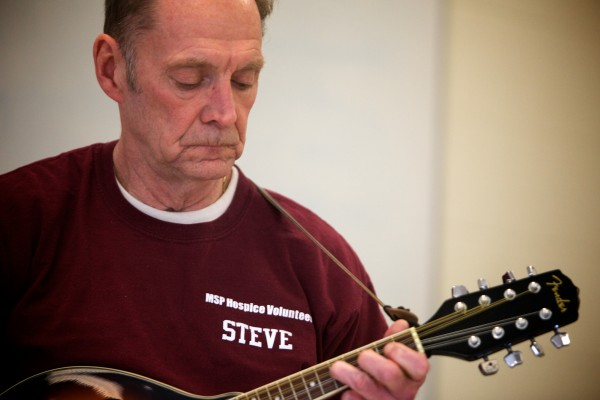 Maine State Prison prisoner Steve Carpentier plays mandolin in a band made up of hospice volunteers on Friday. The band will release a CD in February.