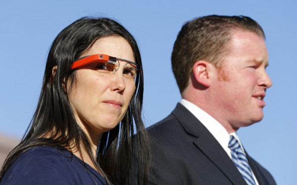 Defendant Cecilia Abadie, left, and her lawyer William Concidine speak to the media after appearing in traffic court to win her Google Glass case in San Diego January 16, 2014. A San Diego court commissioner dismissed a traffic ticket on Thursday against Abadie who drove with Google Glass, a tiny computer mounted on an eyeglass frame.