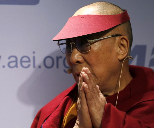 His Holiness The Dalai Lama gestures as he addresses the American Enterprise Institute in Washington February 20, 2014.