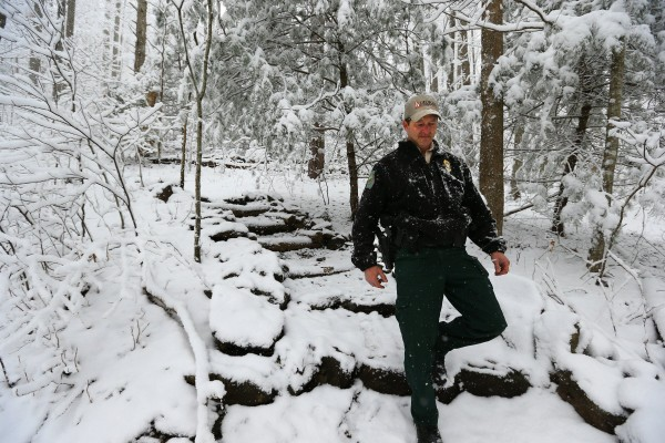 Georgia Department of Natural Resources wildlife technician Scott Bardenwerper works Unicoi Gap on the Appalachian Trail to assist hikers that have been caught out on the trail in the storm and stranded motorists on Tuesday, Feb. 11, 2014, north of Helen, Ga.