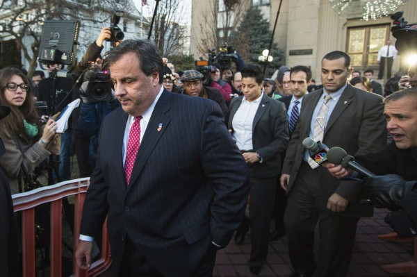 New Jersey Gov. Chris Christie (left) departs City Hall in Fort Lee, N.J., in this file photo taken Jan. 9, 2014.  Former New Jersey official David Wildstein on Friday claimed Christie knew about politically motivated traffic jams as they happened, re-igniting a political scandal that has taken a toll on the prominent Republican.