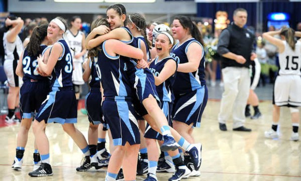 Dirigo's Kelsey Wilson, center left and Emma Lueders hug after a last minute comeback against Saint Dominic Academy during Wednesday afternoon's Western Class C quarterfinals girls basketball game at the Augusta Civic Center.