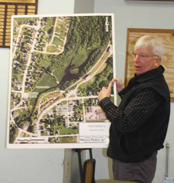 Nick Archer, northern Maine regional office director for the Maine Department of Environmental Protection displays an image showing what areas will be affected by the removal of the Mill Pond dam and berm in Washburn. Archer was one of several local, county and state officials participating last week in a meeting at the Washburn Town Office concerning the project to restore Salmon Brook, which will begin in mid-February.