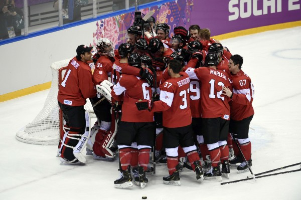 Canada players celebrate after defeating Sweden in the men's ice hockey gold medal game during the Sochi 2014 Olympic Winter Games at Bolshoy Ice Dome on Sunday.