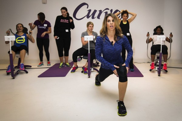 Fitness guru Jillian Michaels gives exercise instructions while promoting her new workout for the Curves franchise in New York January 15, 2014.