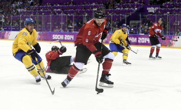 Canada defenseman Shea Weber (center) controls the puck against Sweden forward Alexander Steen (left) in the men's ice hockey gold medal game during the Sochi 2014 Olympic Winter Games at Bolshoy Ice Dome on Sunday.