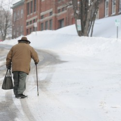 "<a href=""http://bangordailynews.com/2014/02/17/news/state/storm-expected-to-bring-up-to-8-inches-of-snow-to-southern-maine/"">An old man</a> makes his way up a snow covered Center Street in downtown Bangor on Sunday morning."