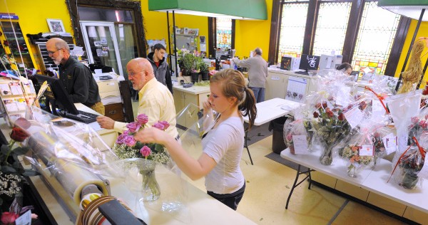 Phil Fredrick (far left), owner of Bangor Floral, said that Valentine's Day is by far the shop's busiest day.