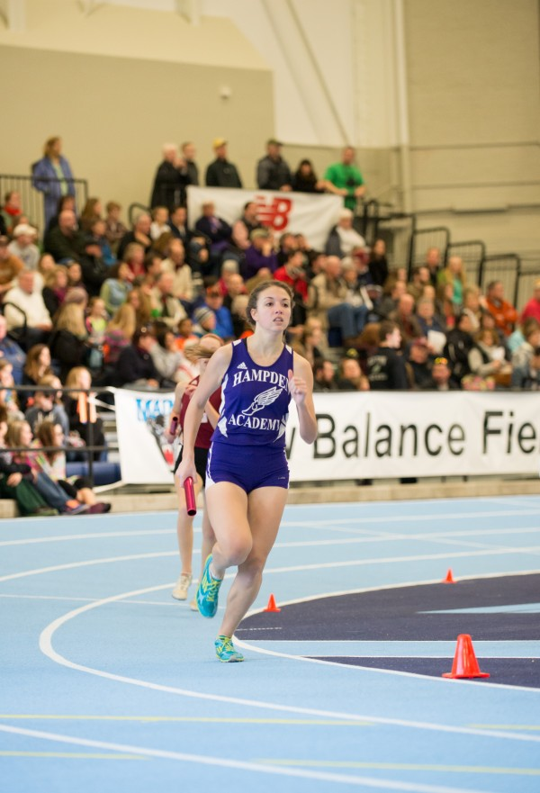 Sarah Tagenhorst competes Saturday in the 4x800 meter relay for Hampden Academy in the PVC State indoor track championship held in Orono at the New Balance Field House.