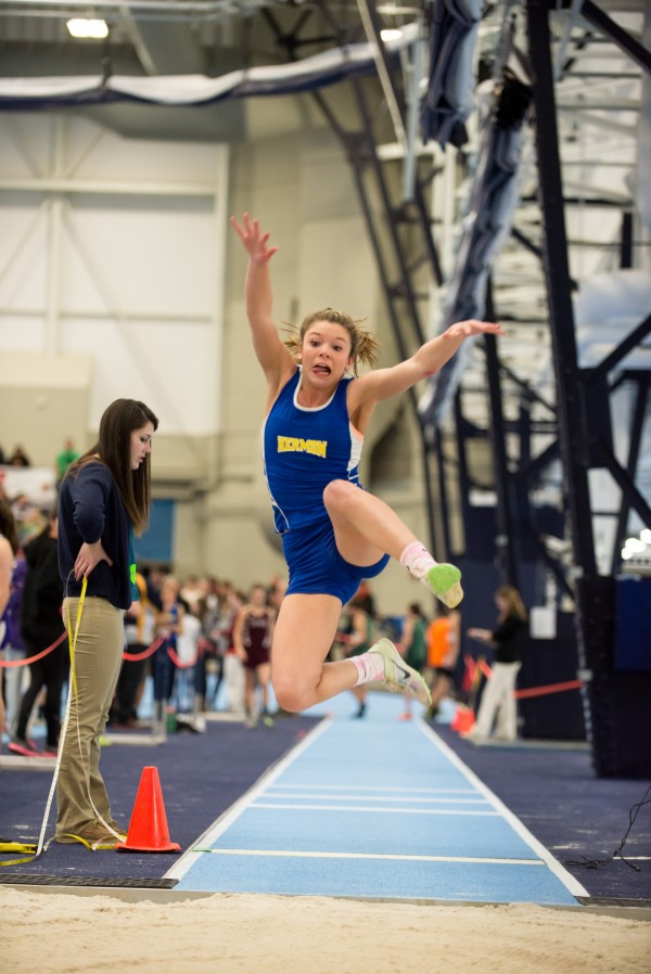 Maddie Page of Hermon High School competes in the girl's long jump in the PVC indoor track championships held Saturday at the New Balance Field House in Orono.