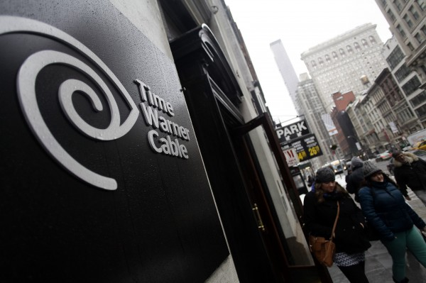 Pedestrians walk past the Time Warner Cable headquarters in New York in this February 2014 file photo. Comcast Corp's proposed $45.2 billion takeover of Time Warner Cable Inc. could face close scrutiny from U.S. antitrust regulators because of the deal's potential to reshape the country's pay TV and broadband markets.