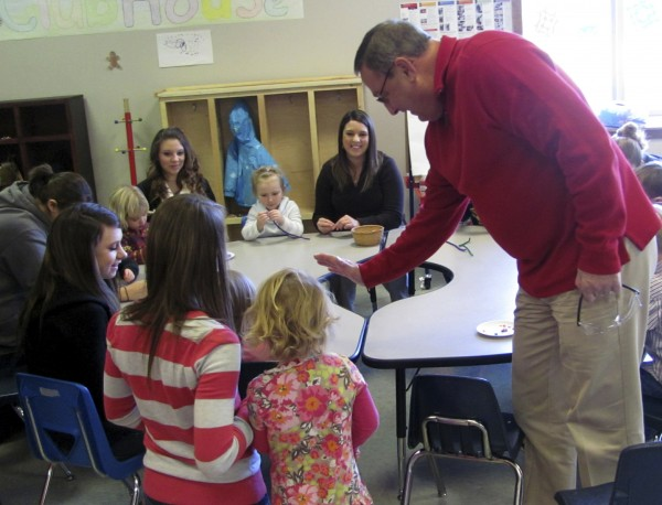 In this December 2011 file photo, Gov. Paul LePage high fives a preschool student who attends Caterpillar Clubhouse, which is part of the early childhood education program offered to high school students at Hancock County Technical Center in Ellsworth.