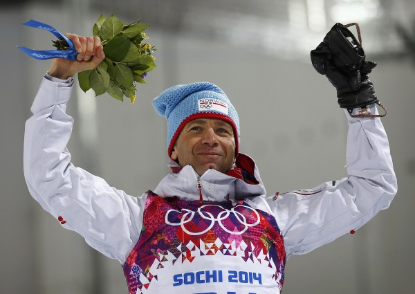 Winner Ole Einar Bjoerndalen of Norway celebrates during the flower ceremony for the men's biathlon 10 km sprint event at the Sochi 2014 Winter Olympics in Rosa Khutor on Saturday.