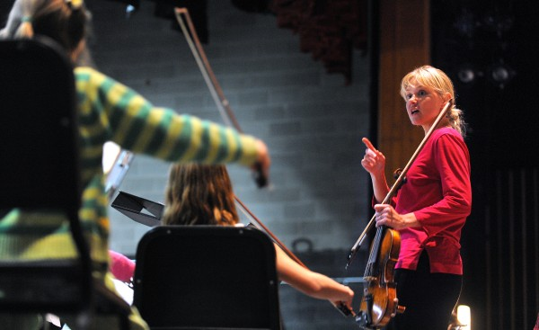 In this October 2013 file photo, Prelude String Orchestra conductor Sascha Zaburdaeva speaks with the musicians during rehearsal at the Bangor High School. Zaburdaeva and Trevor Marcho share conducting duties at the Bangor Symphony Youth Orchestra.